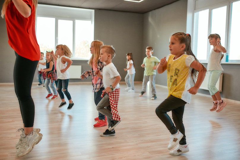 Group of little boys and girls dancing w
