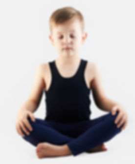 Relaxed child does yoga.handsome little
