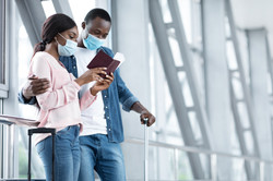 African Couple In Medical Masks Checking
