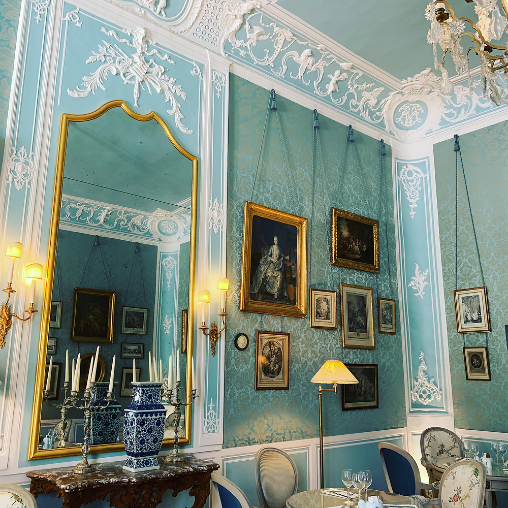 White and blue and gold Louis XIV interior design