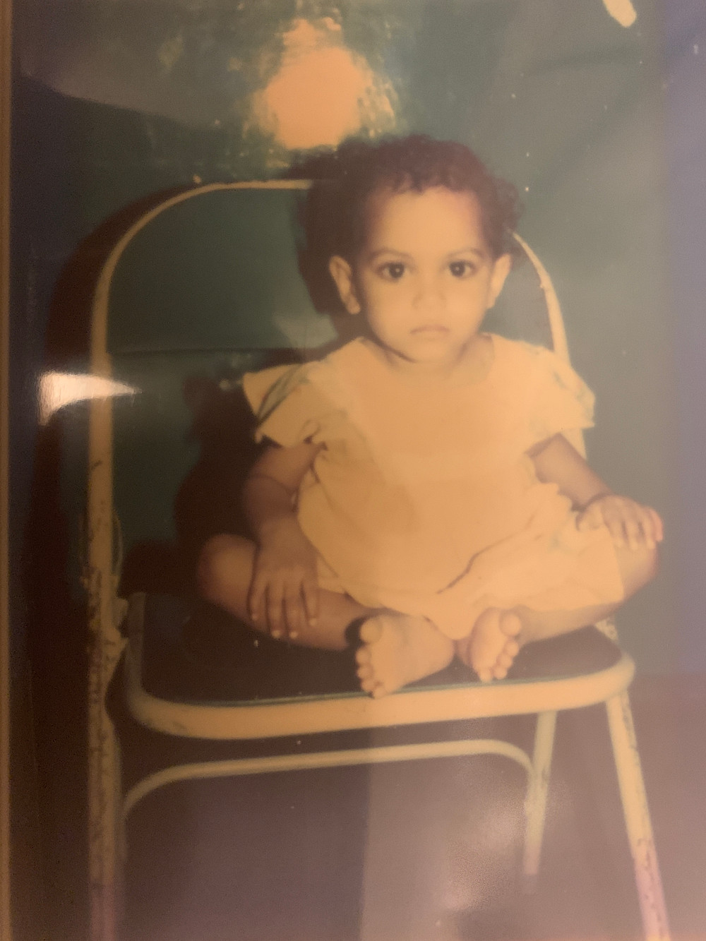 Baby Lata sitting on a chair