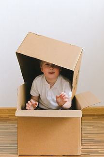 boy-playing-with-boxes-3905692.jpg