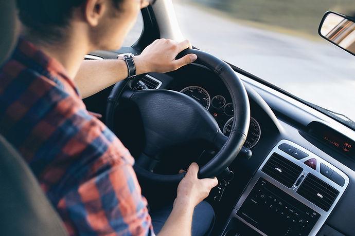 Man Driving in Car