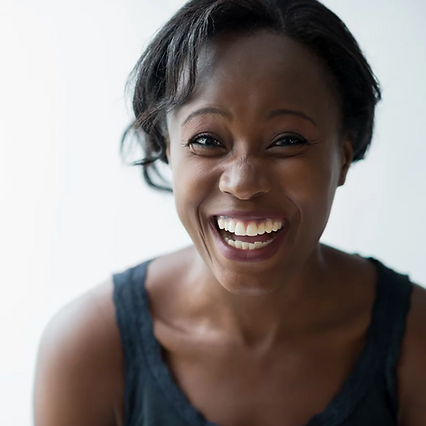 Smiling black woman.png
