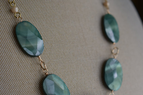 mother of pearl green ovals & gold