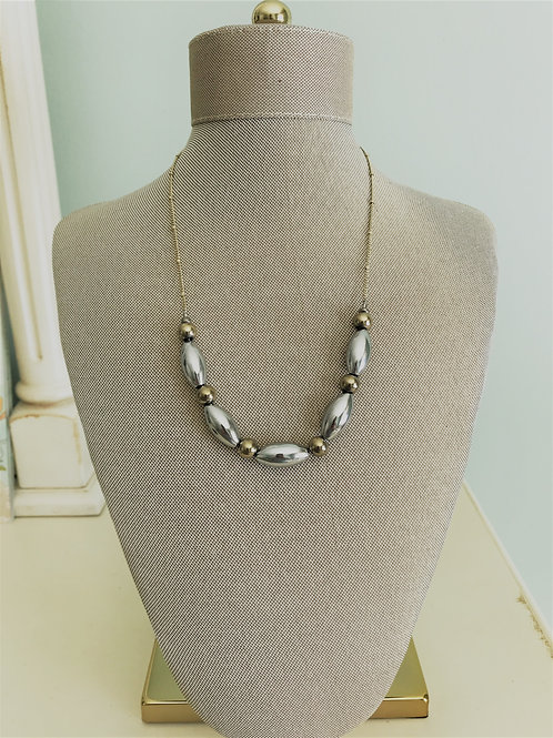 silver and gold hematite