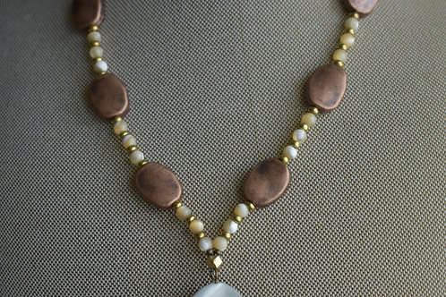 copper ovals and abalone shell