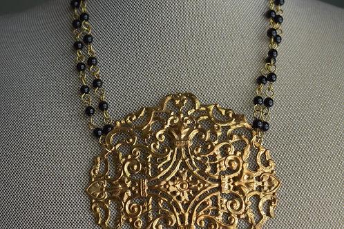 gold medallion & black rosary