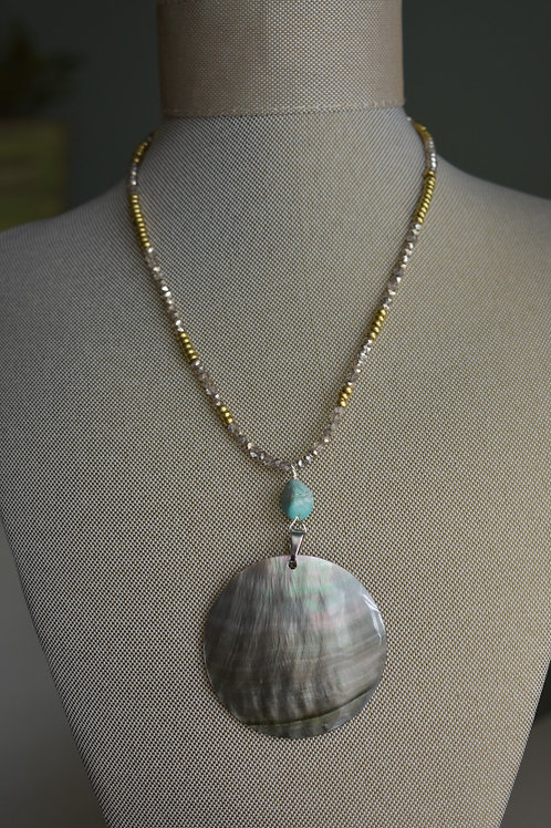 shell disc with turquoise drop