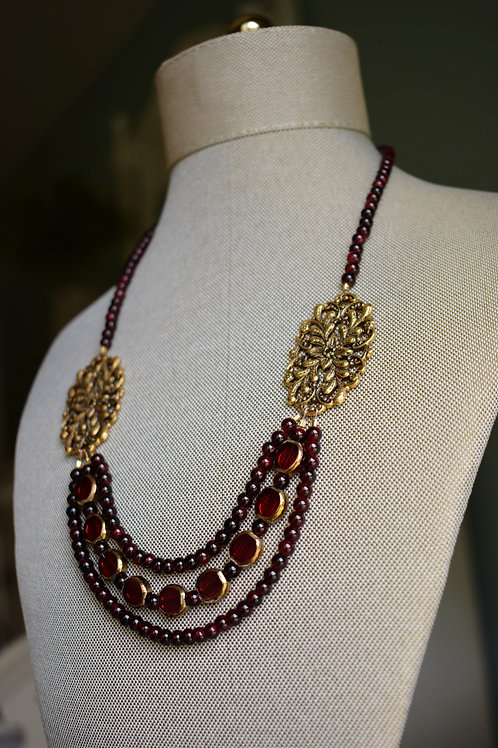 ruby red and gold filigree