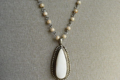 ivory bone pendant with pearl rosary