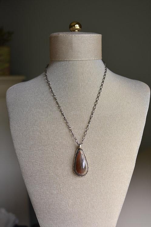 brown bone pendant