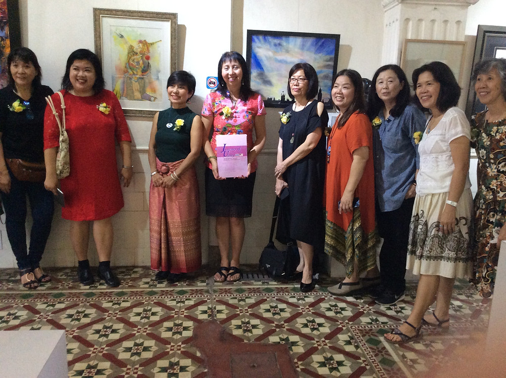 Thai and Malaysian Women artists with Phatchareeboon Urnglaphan's painting next to Panni Loh's painting 'London'