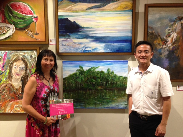 Panni Loh, artist with her painting 'Kedah River' and Vincent Tai, Director of Dai Ichi Modern art gallery