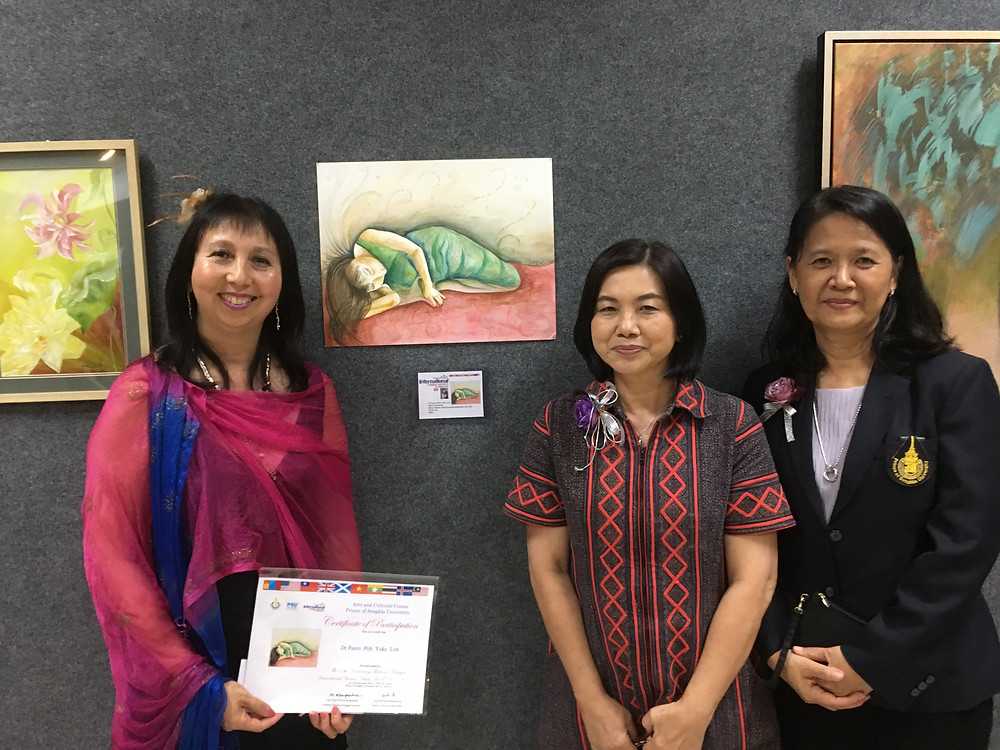 Panni Loh by her painting 'Spirit Dreaming' with Dr. Supatra Davison and Director of the PSU Art Gallery, Hat Yai, Thailand