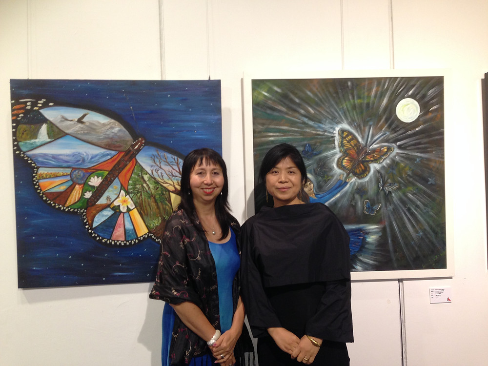 Dr. Panni Loh & Curator Dr. Huang Mei infront of Panni Loh's oil paintings The Wings of Grandmother and Butterfly Dreams (1m x 1m each), Hong Kong City Hall