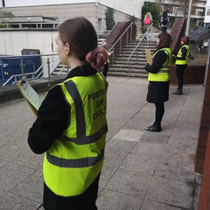 The group outside of the library with our labelled hi vis jackets on, 2019