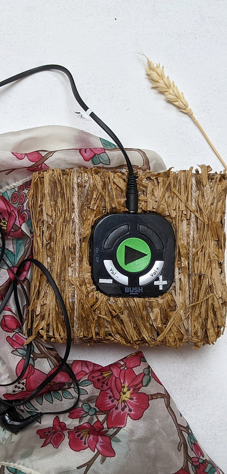 A tiny hay bale, hosting the MP3 player
