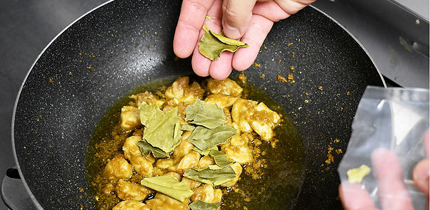 add dried kaffir lime leaves to cooked chicken