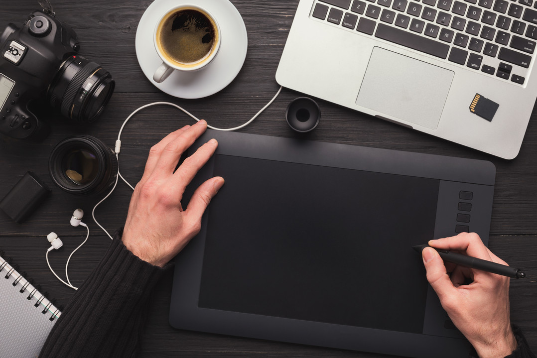 designer-hand-with-graphic-tablet-and-ke