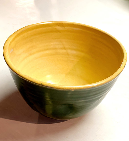 Dark green and yellow medium sized serving bowl