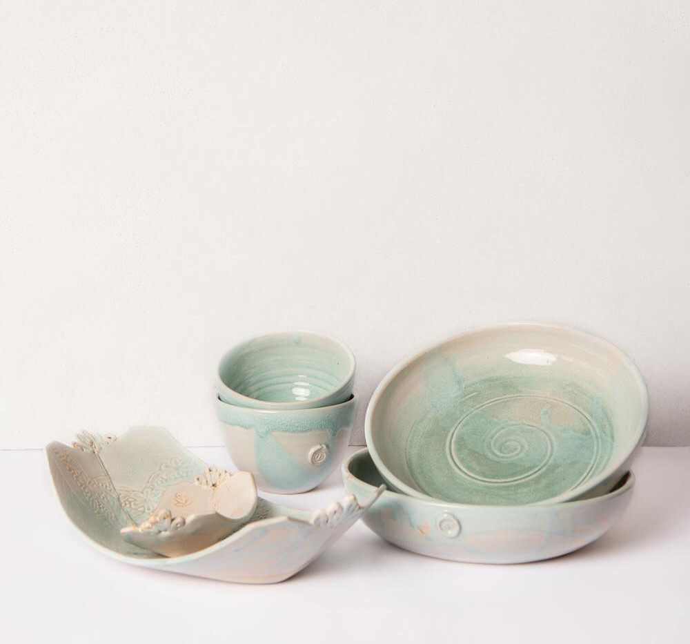 Pasta bowls, serving dish and small bowls in pale turquoise blue