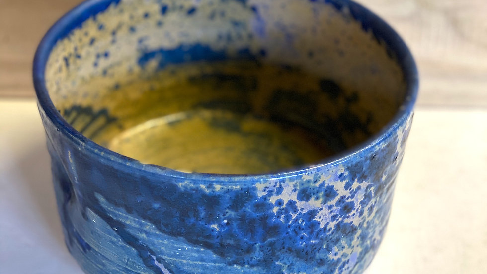 serving bowl- a one off : a single glaze fired blue/yellow with pink highlights