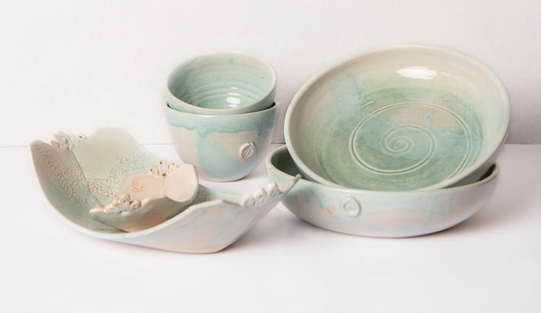 pale blue with green copper highlights  high fired stoneware pasta bowls,serving dishes and small bowls .