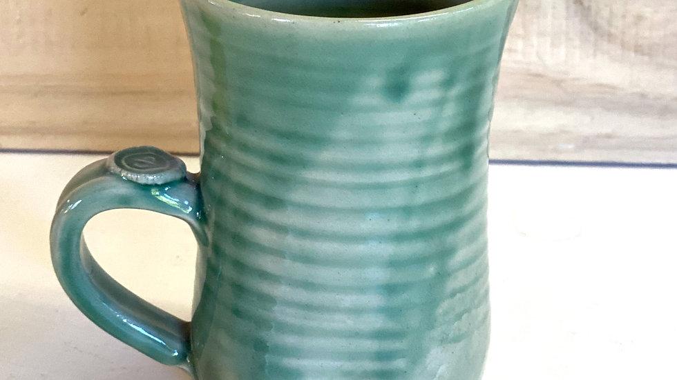 Green ceramic mugs, stoneware.