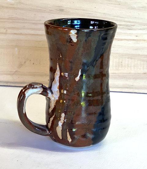 Black, red iron and white stoneware mugs