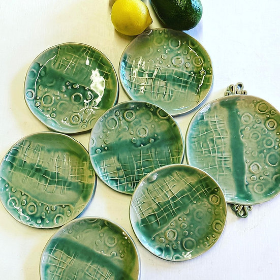 Set of 6 pale green side plates plus one.