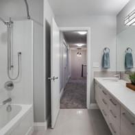 main-bath-with-double-sink-vanity-and-tu
