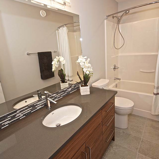 bathroom with quartz countertop