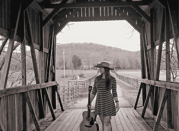 Gillian Leverette standing in a covered bridge