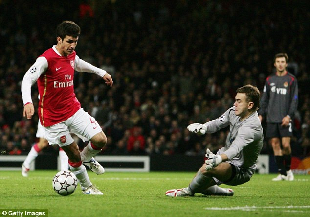 The shot-stopper pictured in action against Cesc Fabregas of Arsenal in 2006 Emirates clash
