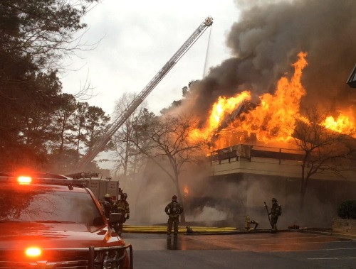 Fire rages above ISDD's offices