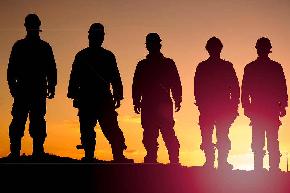 Silhouette of oilfield workers at sunset