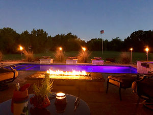 Texas backyard pool retreat at night.jpg