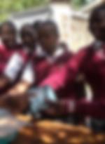 School Children of the slums of Kenya receiving educational materials