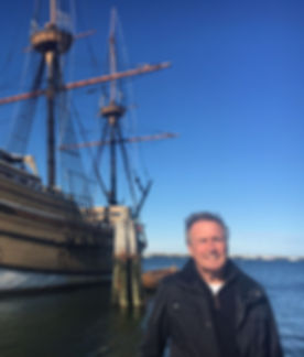 Author Ed Harris standing portside next to The Mayflower
