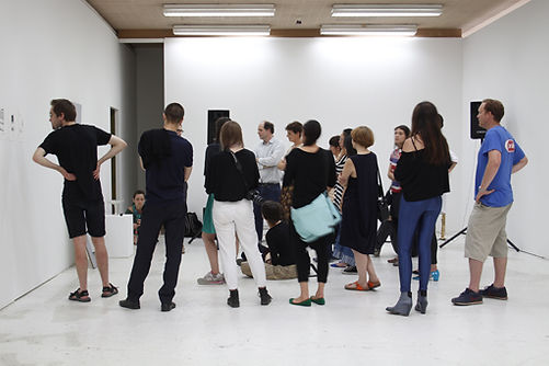 Autocenter Contemporary Art Berlin, Summer Academy, 2014; Artist Tyler Mallison discussing Pinball Communion with fellow artists
