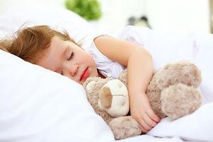 Child Little Girl Sleeps In The Bed With Teddy Bear.jpg