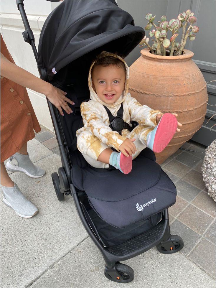 Baby in lightweight compact Ergobaby travel stroller