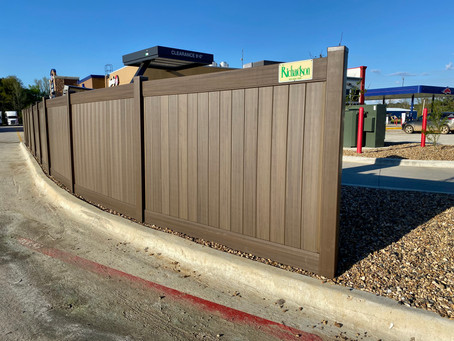 Brown Vinyl privacy fence for Road Ranger project in New Boston, Tx