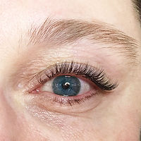Close up of blue eyes and natural eyelash extensions.