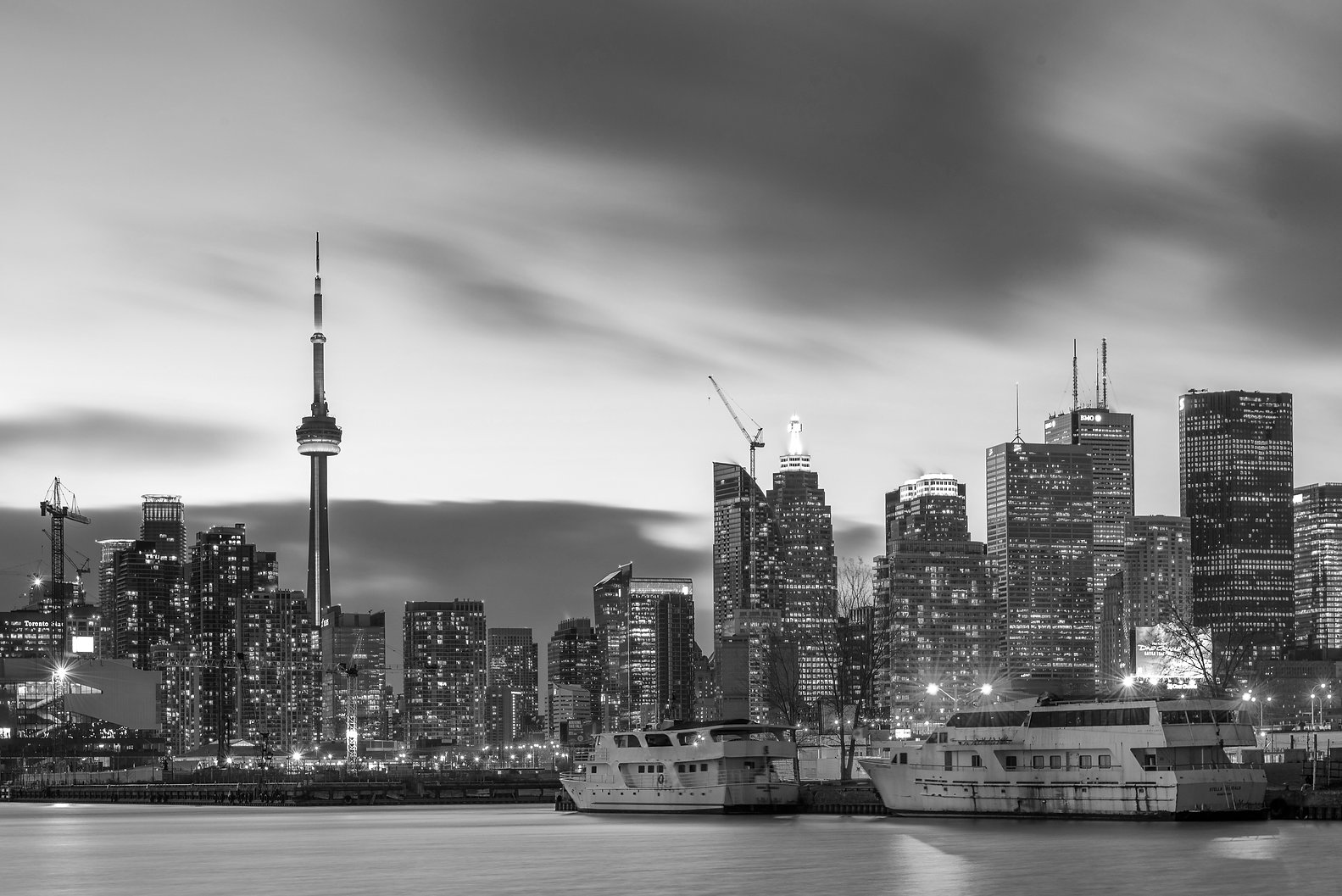 Toronto skyline with boats in he foreground