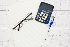 Calculator and glasses to represent accounting.