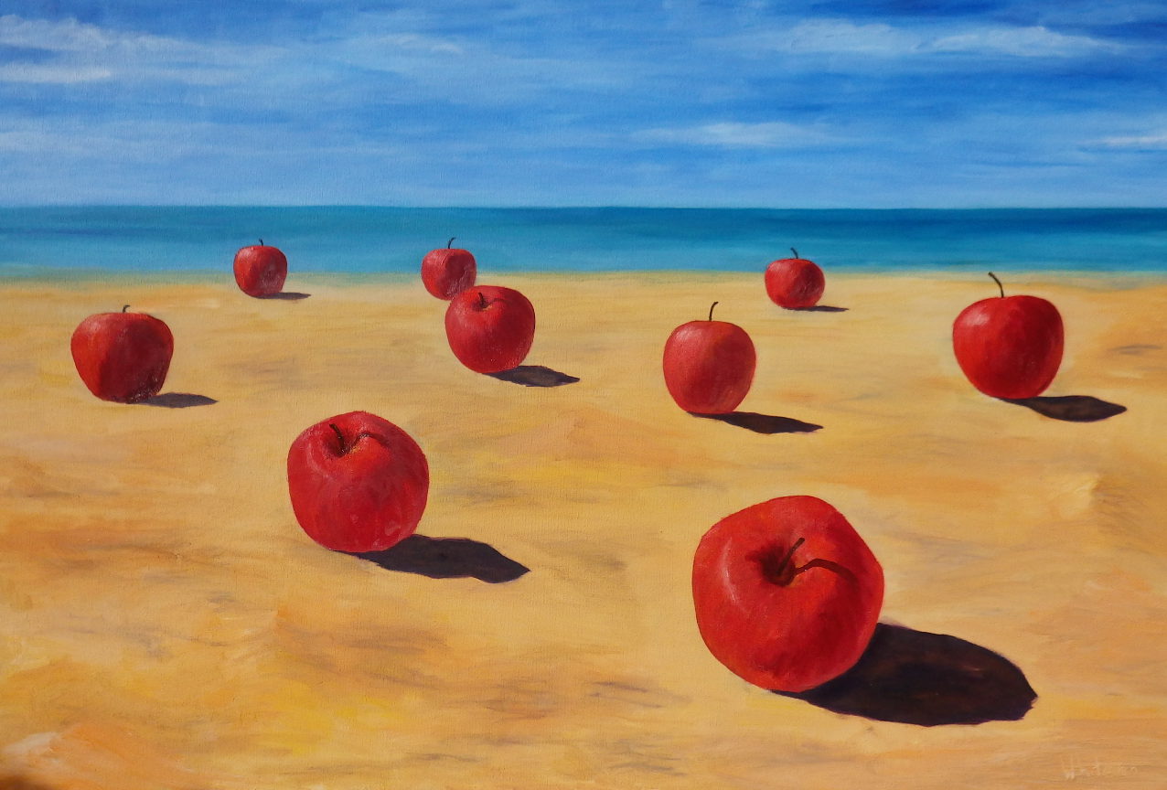 Apples on a sandy beach