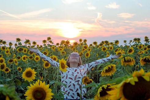 girlinsunflowers.jpg