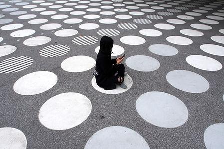Woman Sitting on Street